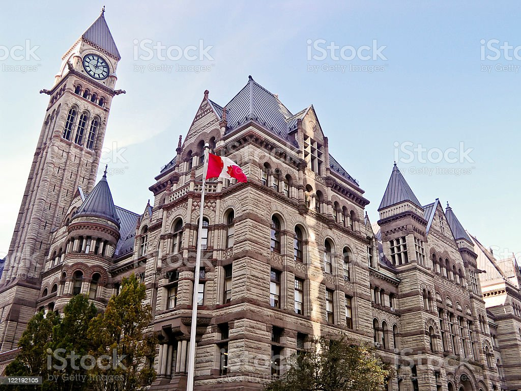 A building in Toronto with the Canadian flag out front stock photo