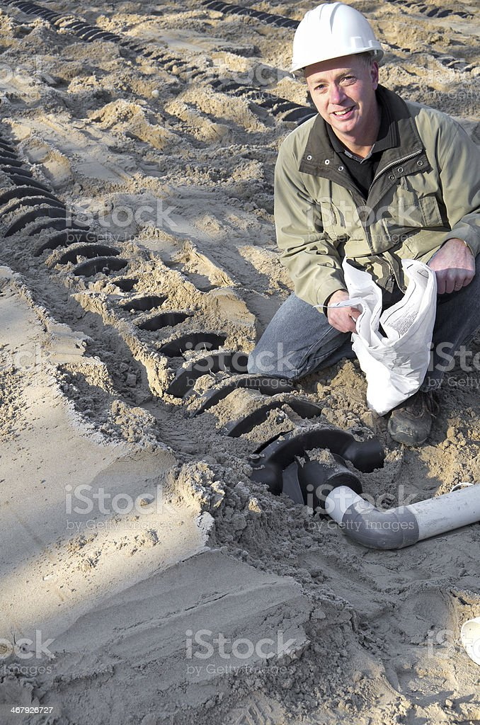Building Inspector and Septic System royalty-free stock photo
