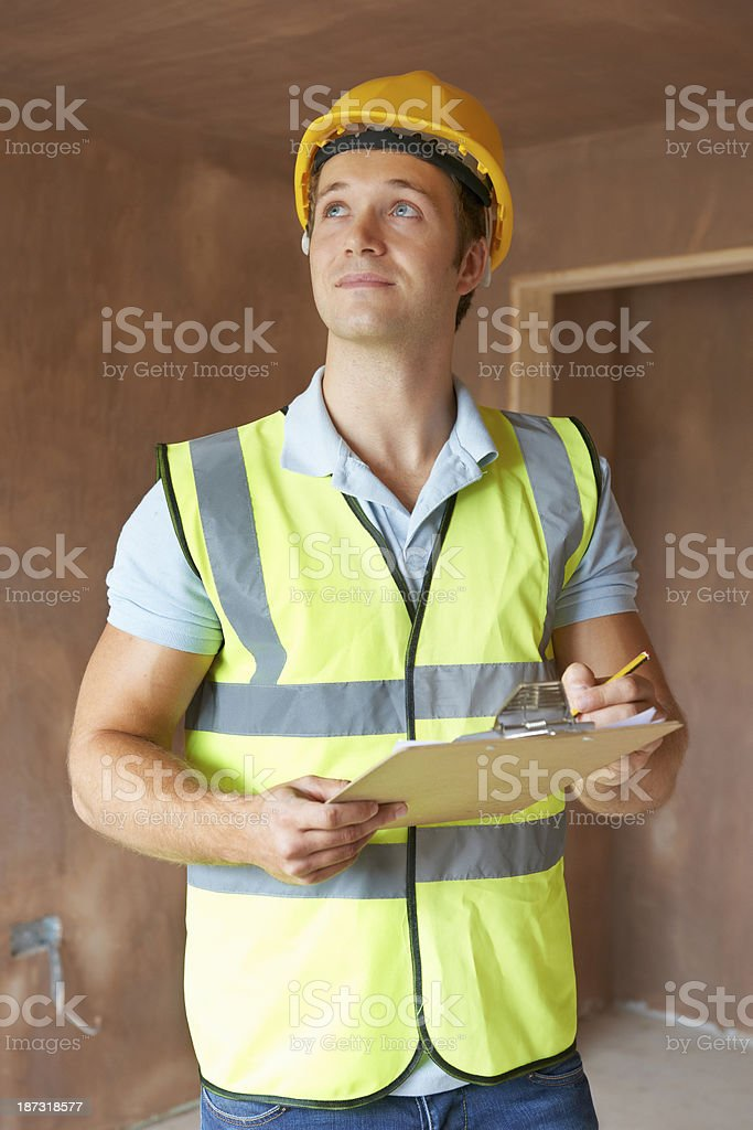 Building Inspector Looking At New Property royalty-free stock photo