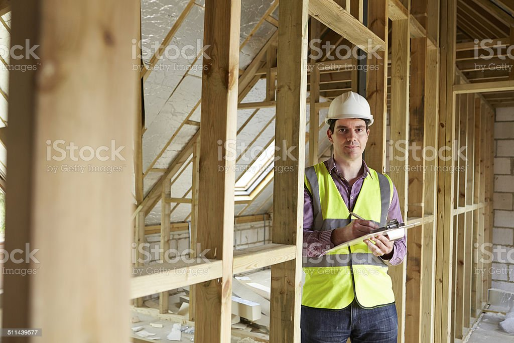 Building Inspector Looking At New Property stock photo
