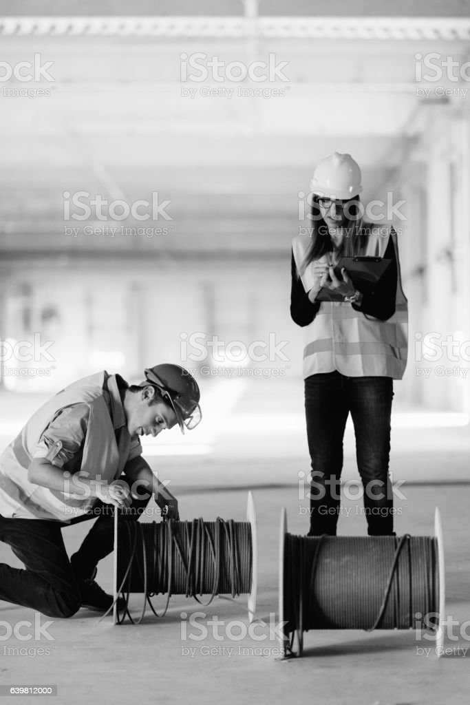 Building inspectors at a construction site stock photo