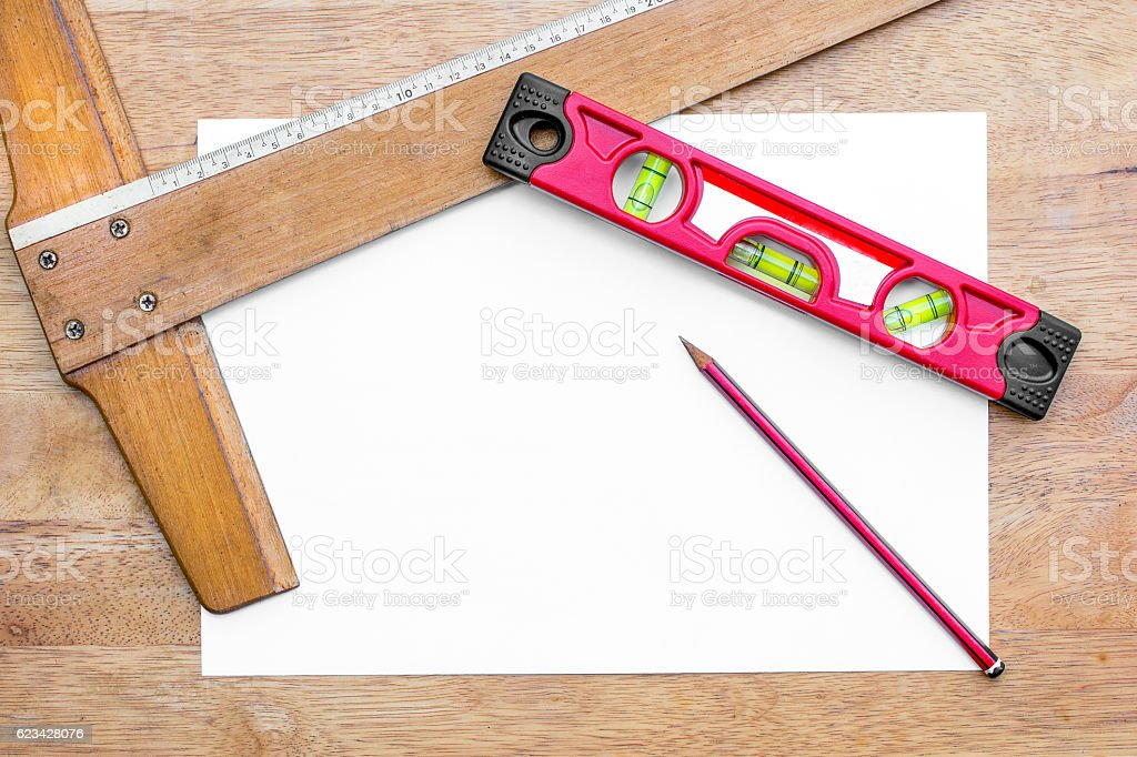 Building level,T square ruler and pencil stock photo