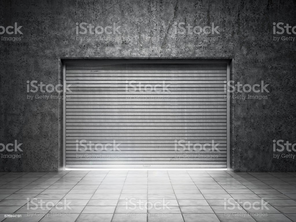 Building made of concrete with roller shutter door stock photo