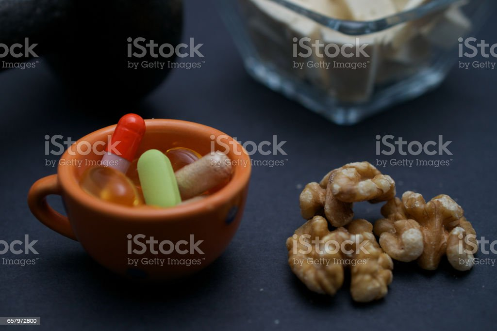 Building muscle on vegan diet and supplements stock photo