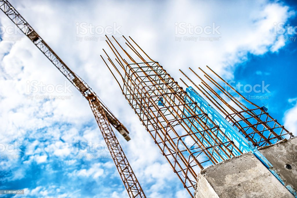 Building of skyscraper with crane, tools and reinforced steel bars stock photo