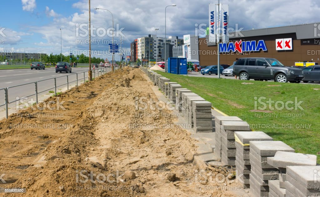 VILNIUS, LITHUANIA - AUGUST 12, 2016: Building of the new pedestrian and bicycle road near shop of a distribution network Maxima. It is the most environmentally friendly district of the Lithuanian capital - Pilaite stock photo