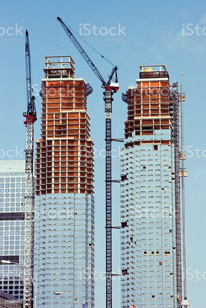 Building of two skyscraper: hosting crane royalty-free stock photo