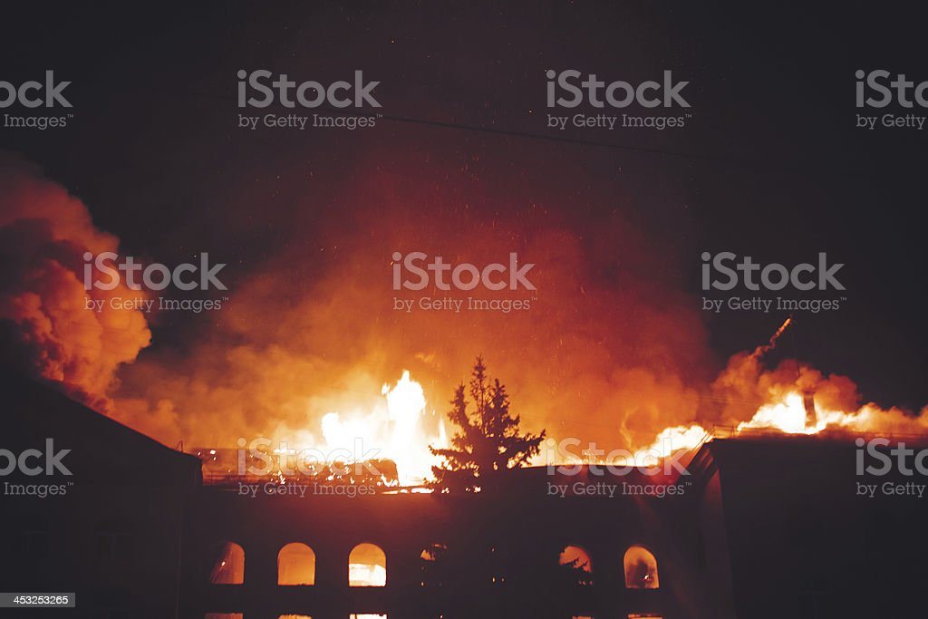 Building On Fire At Night stock photo