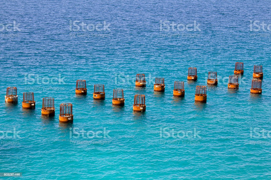 Building pier foundation in the sea stock photo