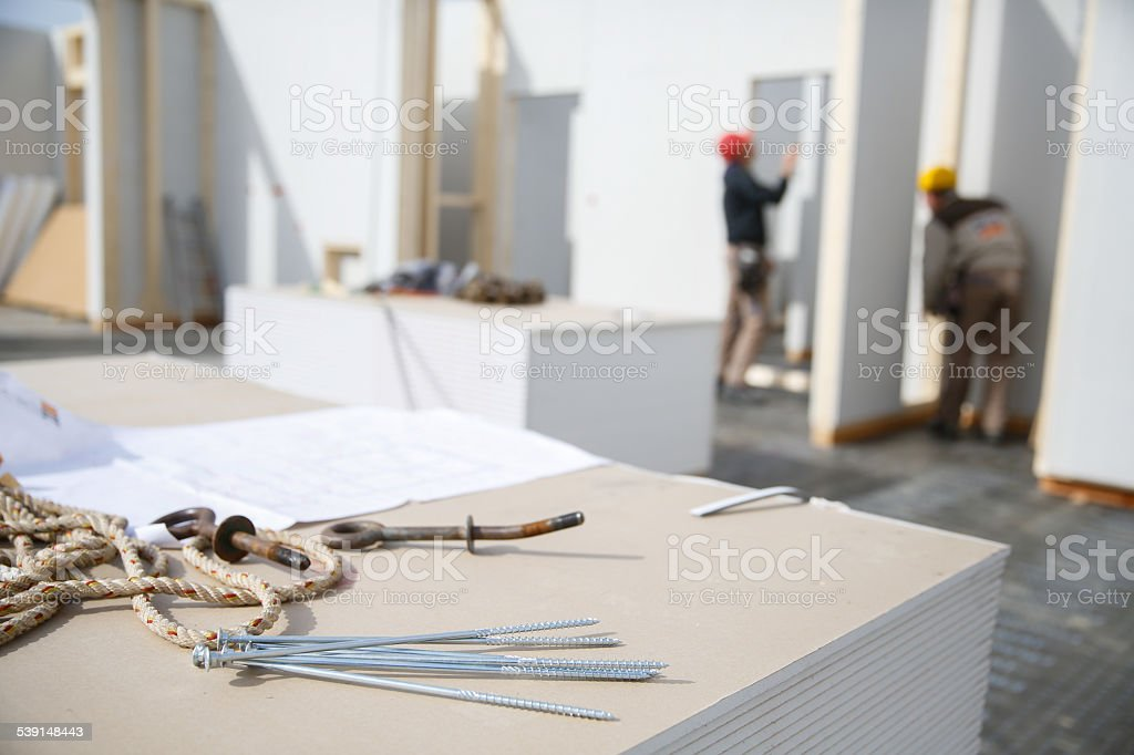 Building plan and workers in the background stock photo