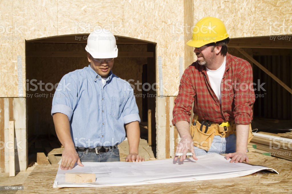 Building plan review stock photo