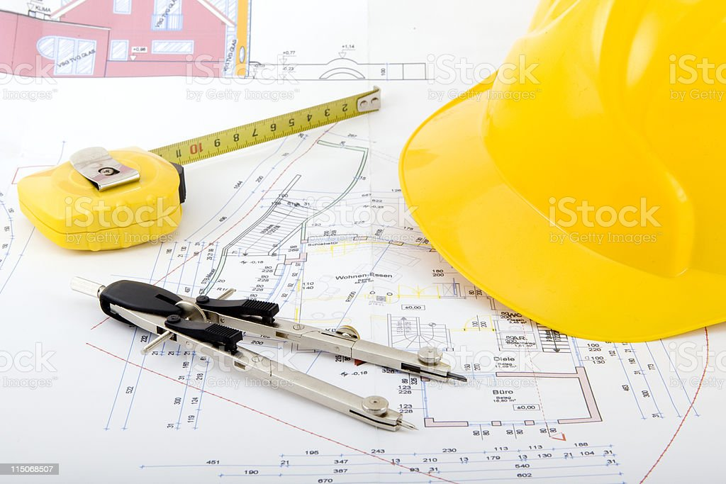 Building plan with safety helmet royalty-free stock photo
