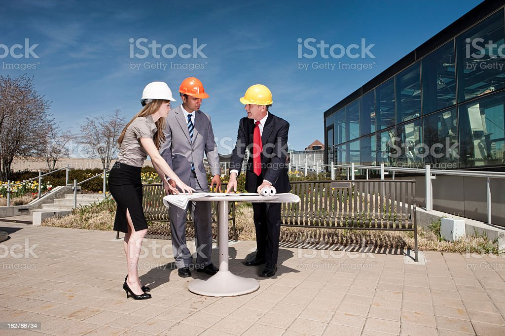 Building Planners Studying Blueprints royalty-free stock photo