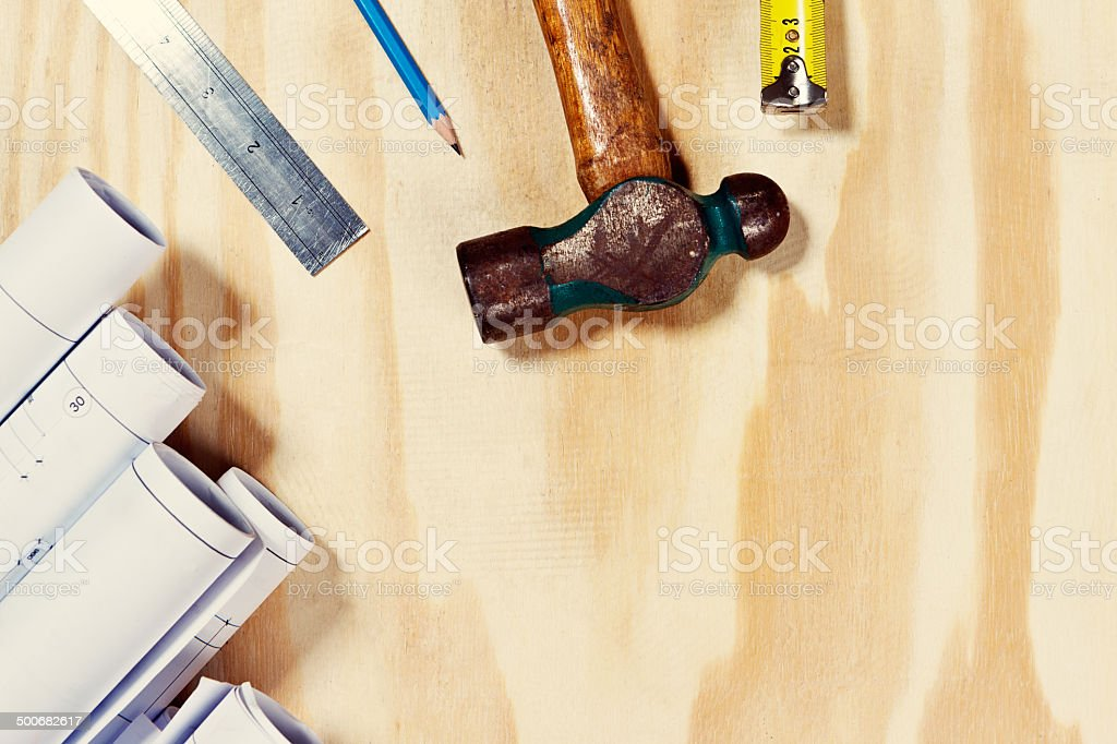 Building plans and hand tools form border on wood royalty-free stock photo