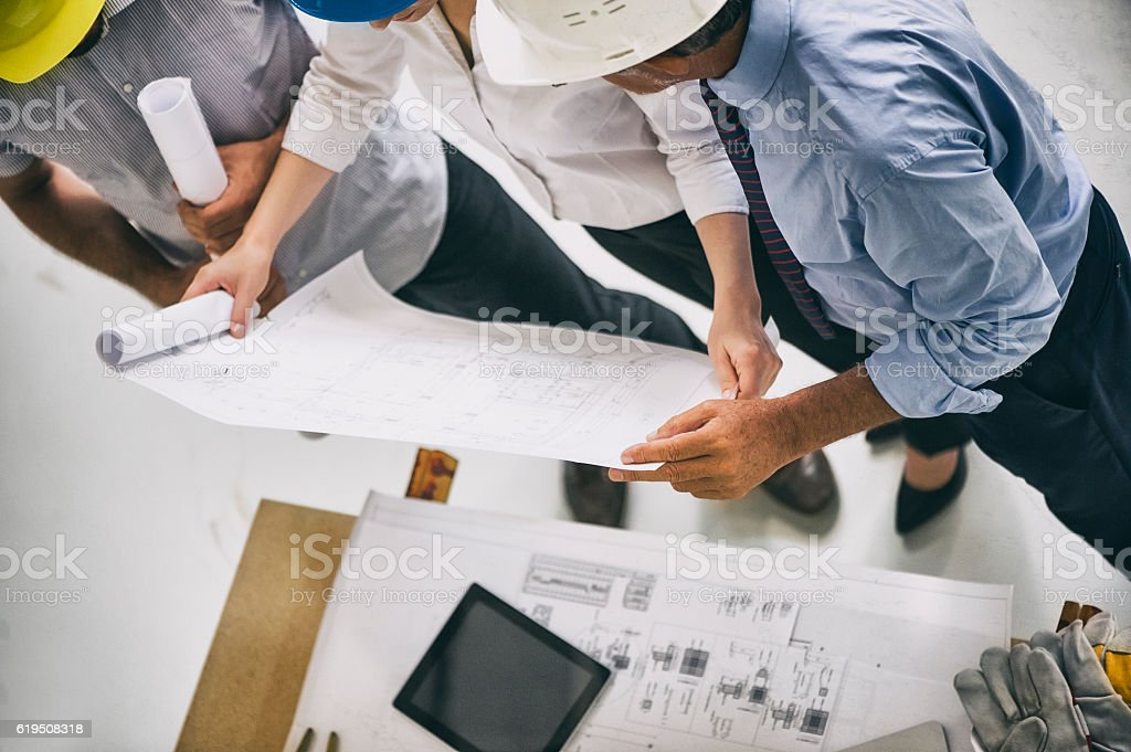Building professionals meeting on site stock photo