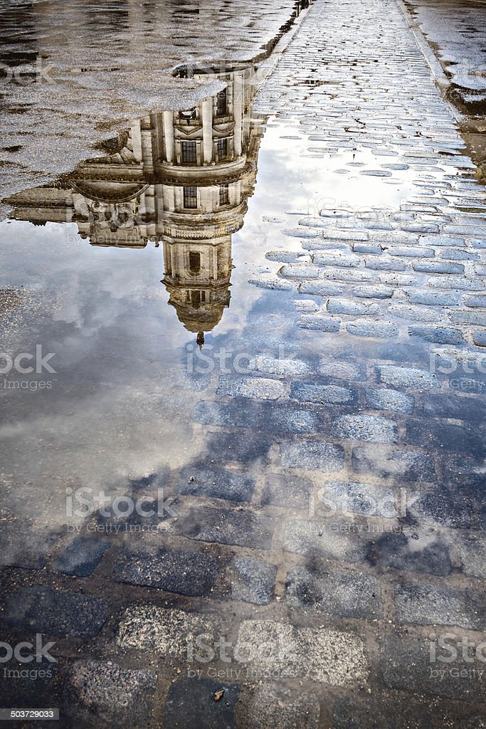 Building reflected in a puddle in London, England United Kingdom stock photo