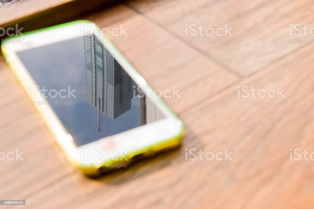 Building reflection on mobile screen. Slow life and relax concept,...