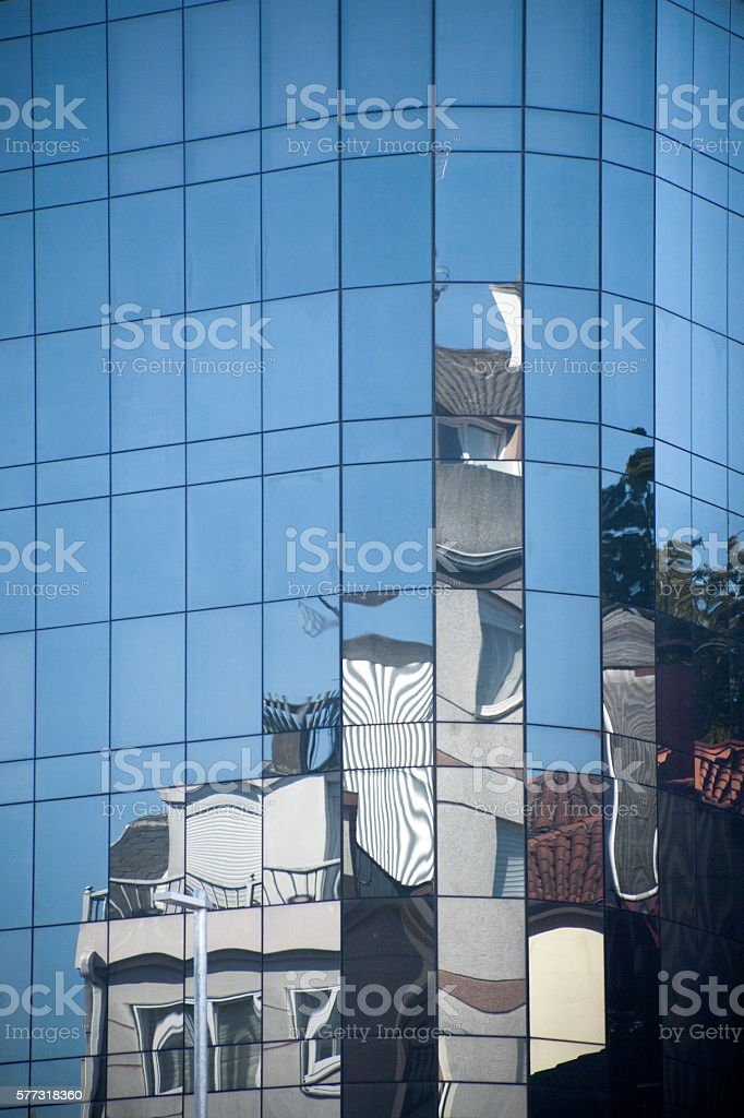 Building reflections on a glass facade. stock photo