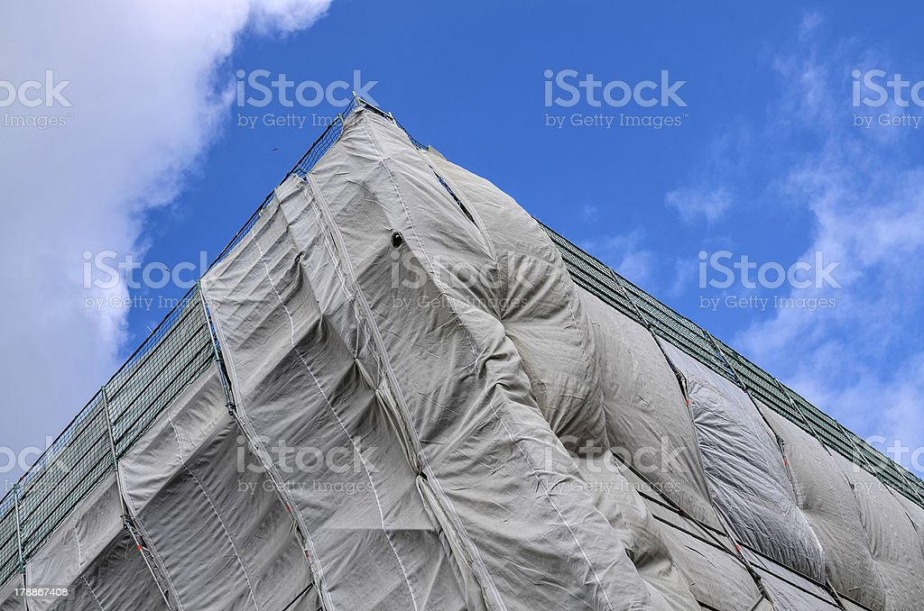 Building site covered in gray tarpaulin royalty-free stock photo