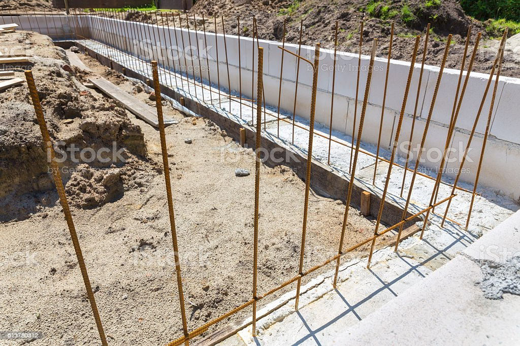 Building site with iron bars in concrete foundation stock photo