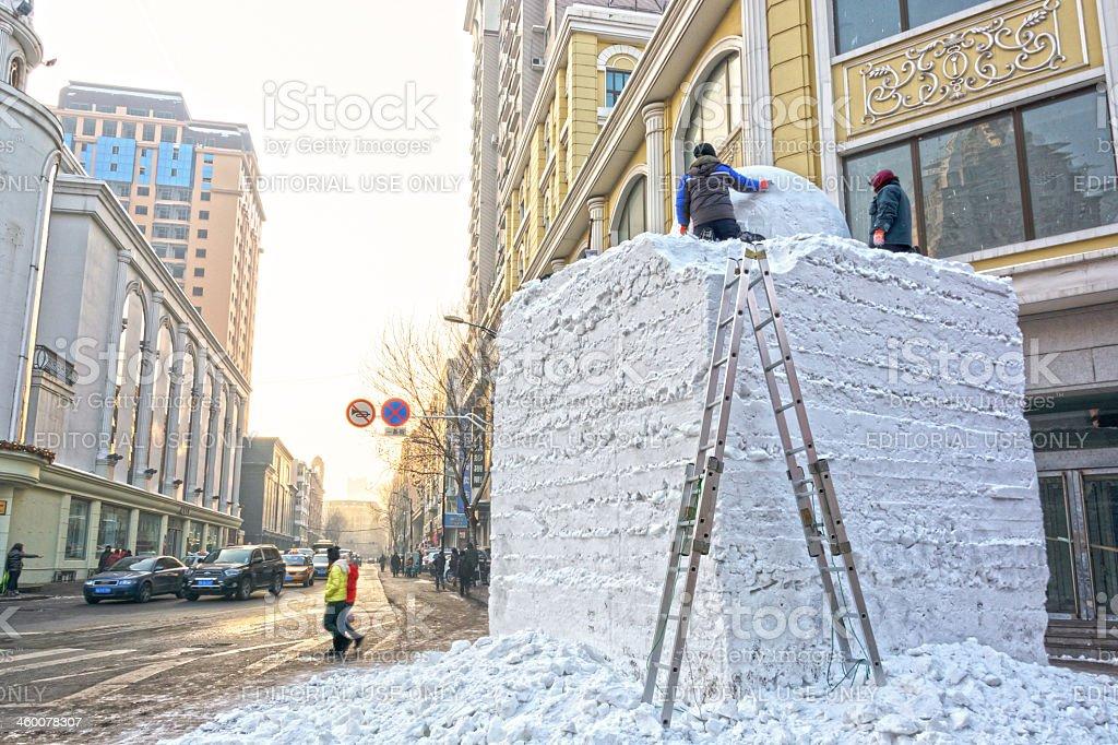 Building snow sculpture stock photo