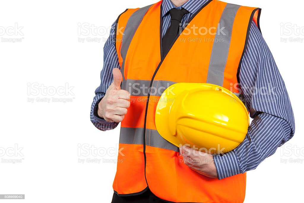 Building Surveyor in orange visibility vest giving the thumbs up stock photo