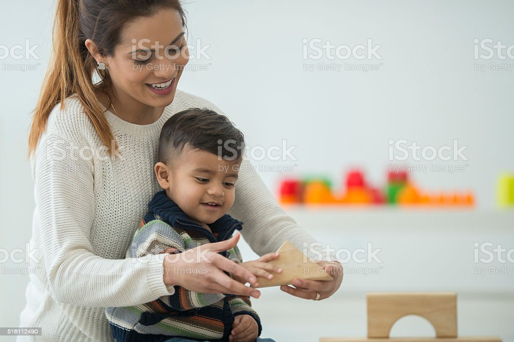 Building Towers with Wood Blocks stock photo