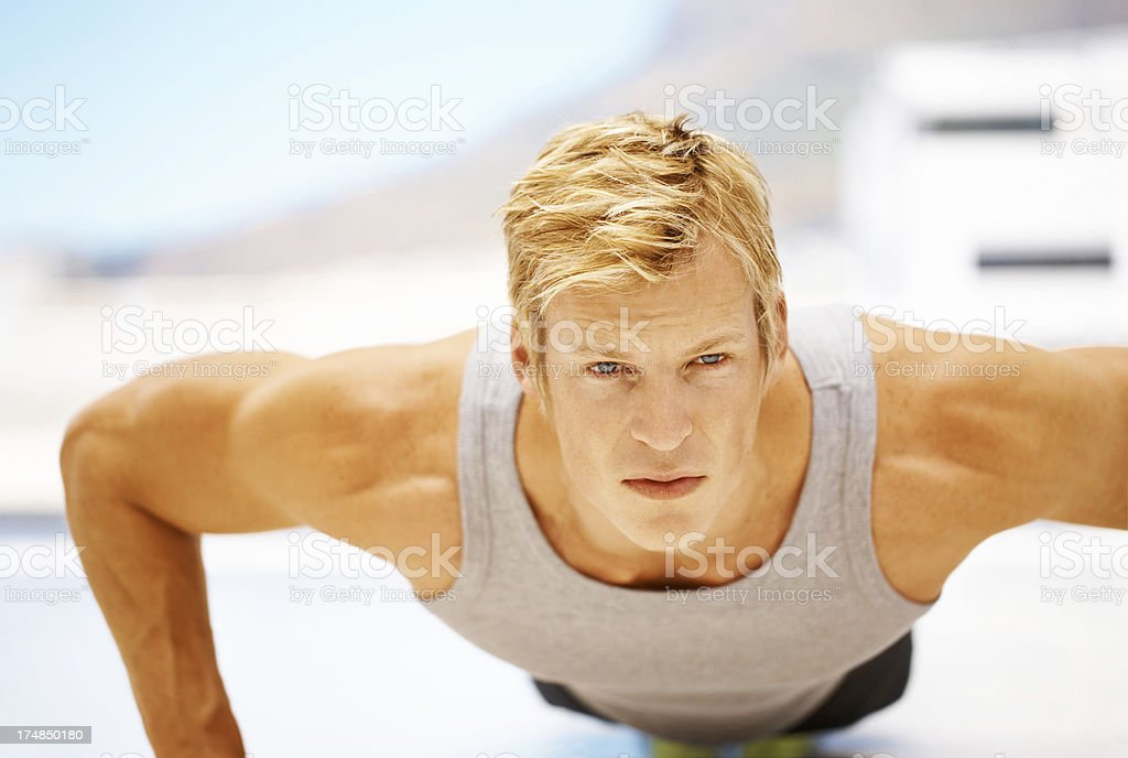 Building up his chest royalty-free stock photo