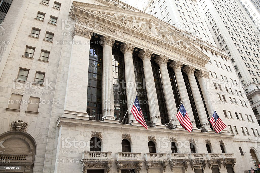NYSE building with American flags royalty-free stock photo