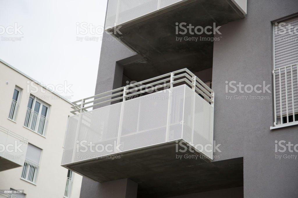 Building with balcony, iron grill, iron balcony stock photo