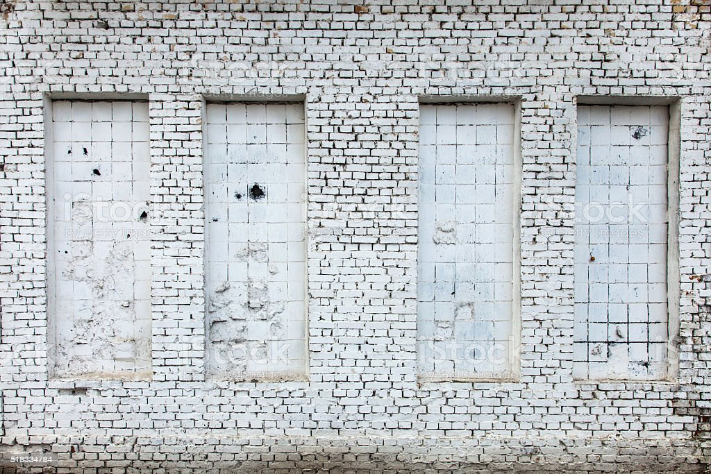 Building with bricked up window stock photo