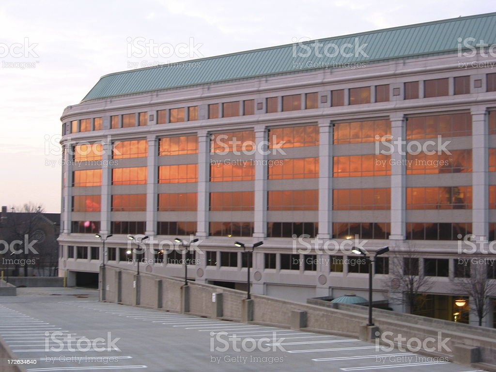 Building With Burning Clouds and Car Park - A royalty-free stock photo