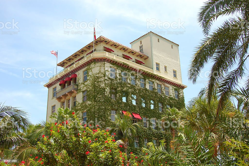 Building with bush and palms royalty-free stock photo
