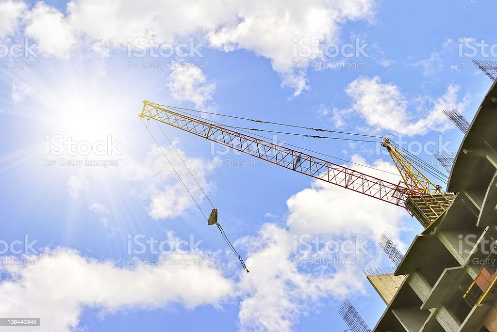 Building with elevating crane royalty-free stock photo