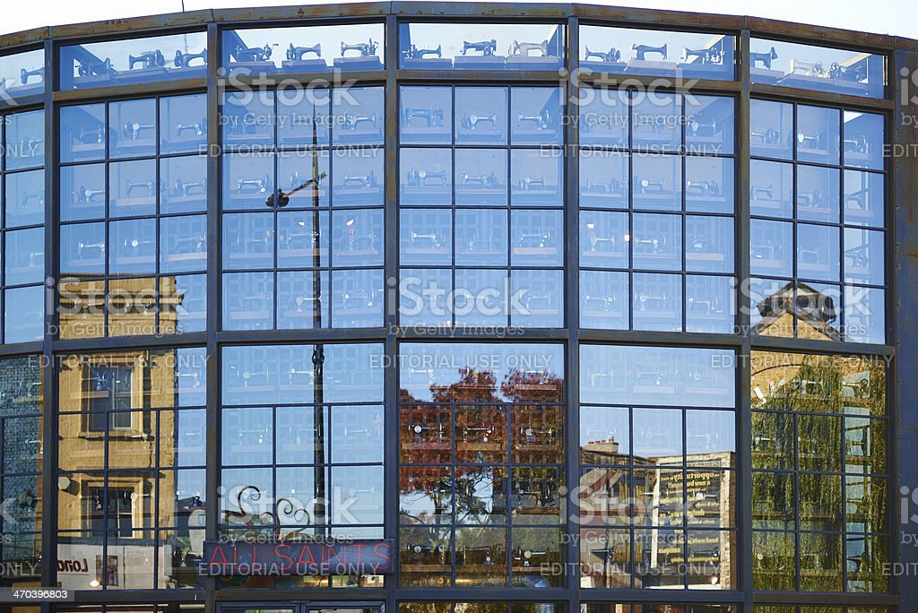 Building with glass facade reflects the surrounding area royalty-free stock photo