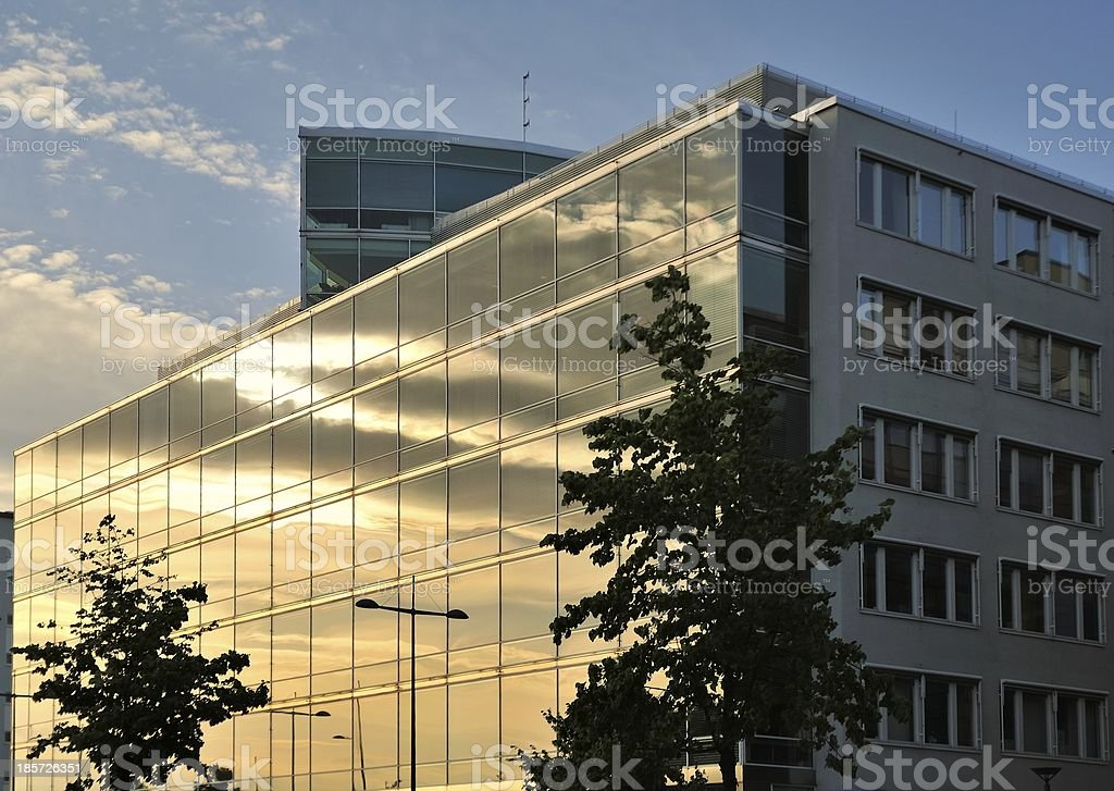 Building with huge glass facade at sunset royalty-free stock photo