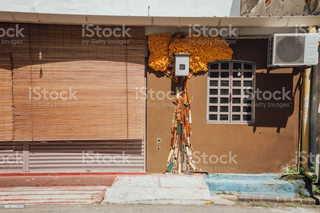 Building with like tree decoration on the wall in George Town. Penang, Malaysia. stock photo