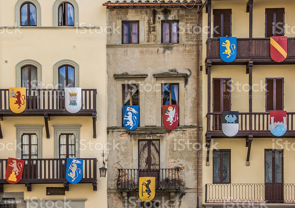 Building with medieval shields at the Piazza Grande in Arezzo stock photo