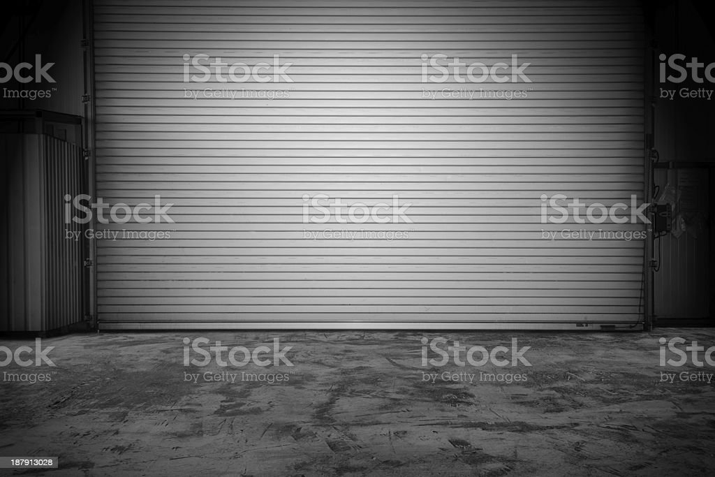 Building with roller shutter door stock photo