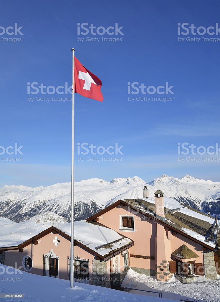 Building with swiss flag on the alpine skiing resort royalty-free stock photo