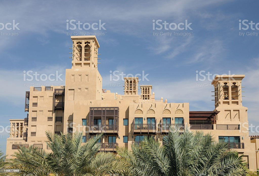 Building with traditional Wind Towers in Dubai royalty-free stock photo