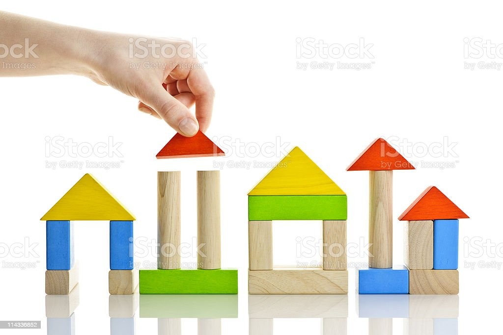 Building with wooden blocks stock photo