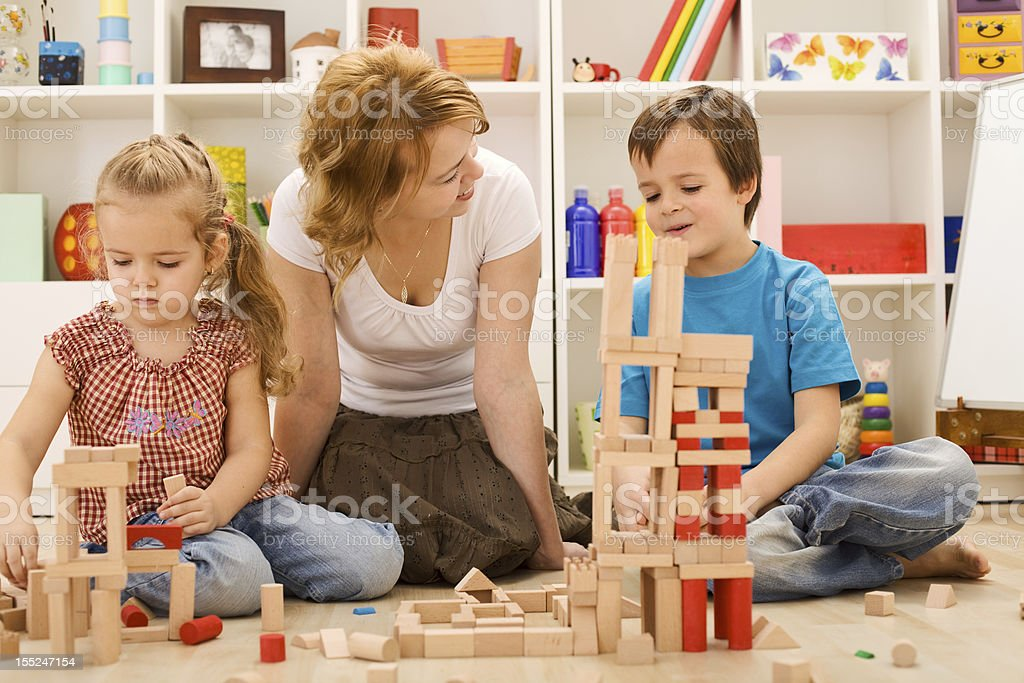 Building with wooden blocks together is fun stock photo