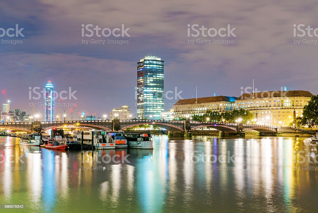 Buildings and boats at night stock photo