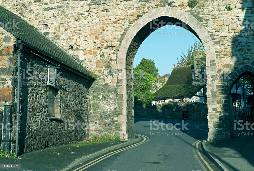 Buildings and medieval wall in Conwy Wales stock photo