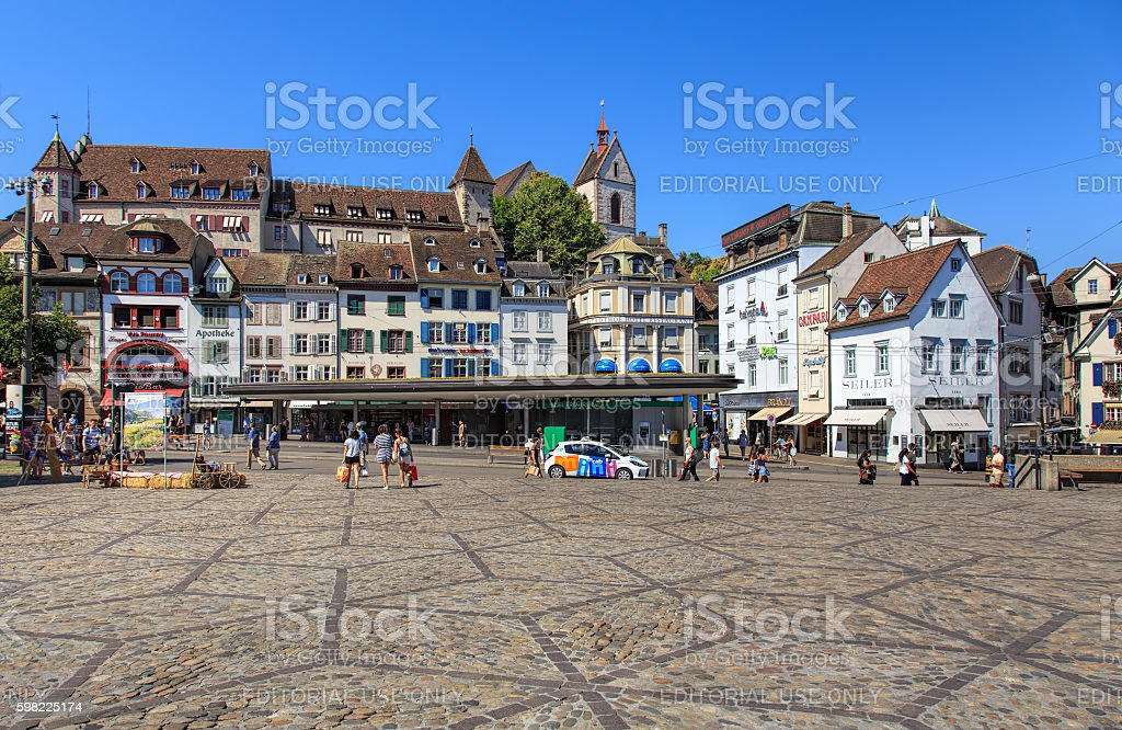 Buildings and people on Barfuesserplatz square in Basel, Switzerland stock photo