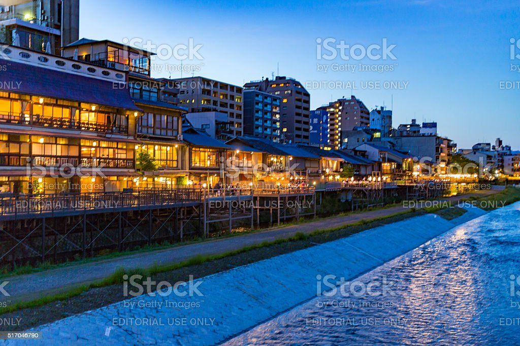Buildings and the Kamo River in Kyoto Japan at Sunset stock photo