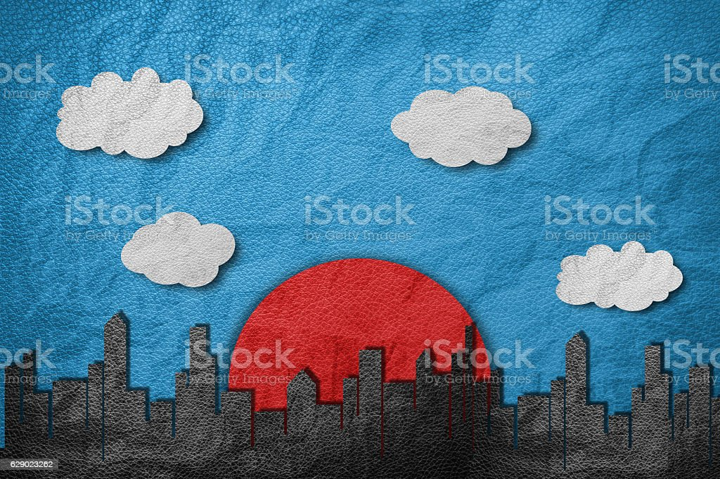 Buildings in city with red sun, cloud and blue sky stock photo