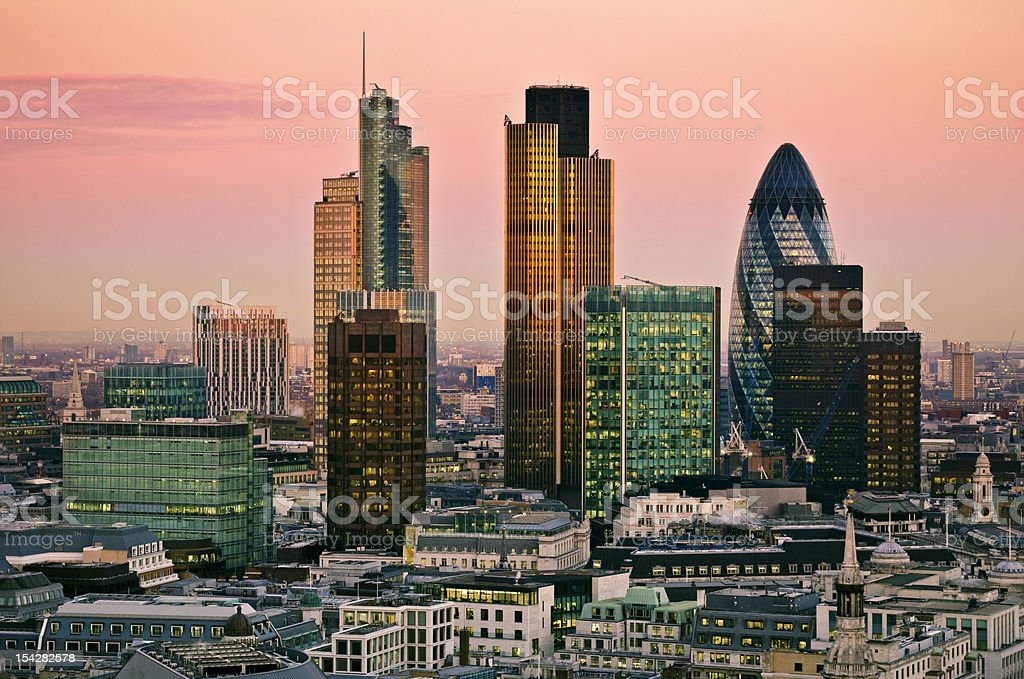 Buildings in the city of London under a pink sky at twilight royalty-free stock photo