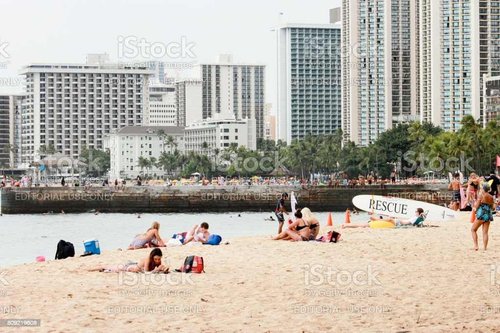 Buildings lining popular tourist destination Waikiki Beach. stock photo